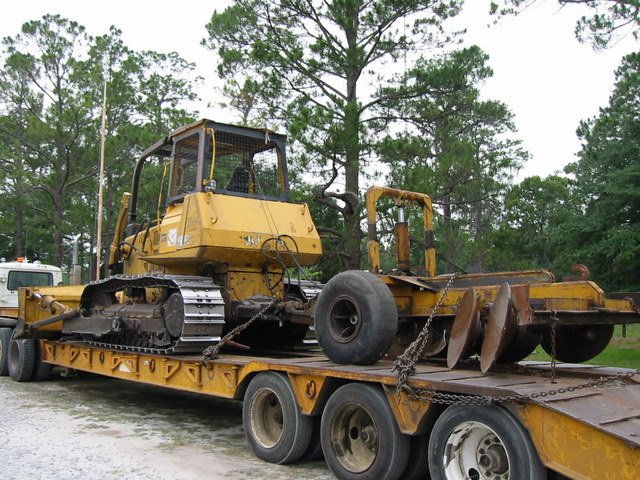 tractor plow on trailer
