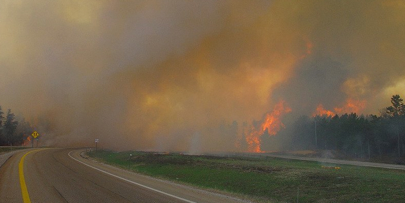 According to Paul Kollmeyer of the DNR, the Grayling fire was one of few capable of jumping a 4-lane highway and median. This photo depicts the fire as it continues its charge toward Grayling. It also shows the fire has already jumped across I-75. DNR photo.