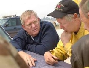 Gov. Bill Janklow and South Dakota Wildland Fire Coordinator Joe Lowe look over a map during the Battle Creek Fire of 2002. Photo: Rapid City Journal