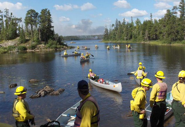 firefighters in canoes