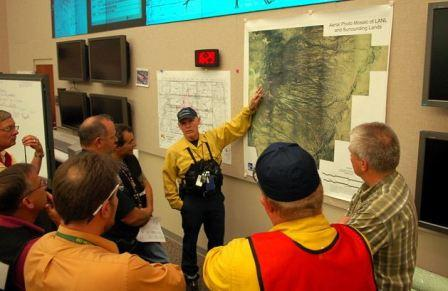 Los Alamos Fire Department Chief Doug Tucker updates status of Las Conchas Fire on a map in the Emergency Operations Center at Los Alamos National Laboratory. Photo: Los Alamos National Laboratory.