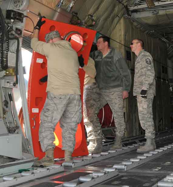 Crews install the replacement door for the MAFFS II in 2011 before deployment to assist with wildfires in Texas. Photo by Master Sgt. Paul Mann.