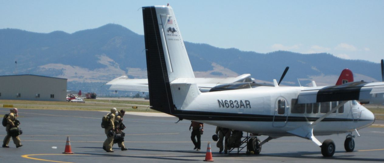 Smokejumpers loading onto an aircraft