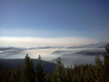 Chrandal Creek Fire smoke drifts over the valley on 07/25