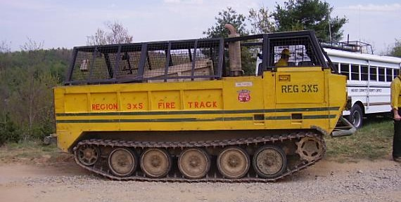 Tracked vehicles for fire suppression
