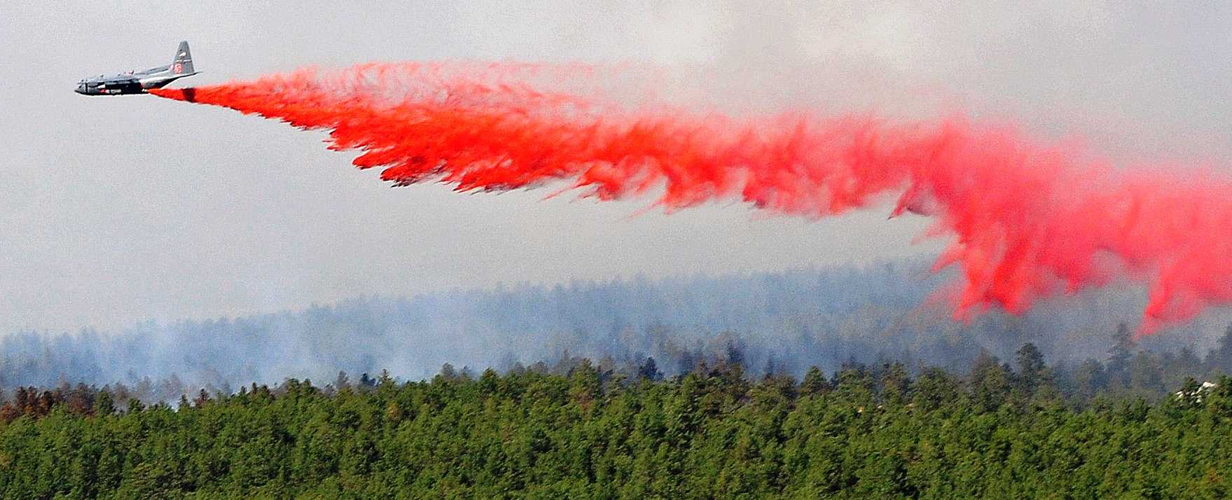 MAFFS C-130 drops retardant on the Black Forest Fire