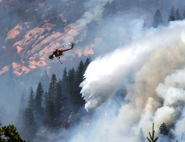 Sikorsky helicopter dropping on Springs Fire, July 26, 2013