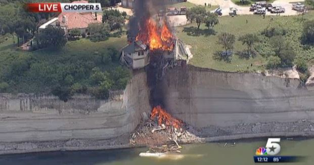 House above lake burning