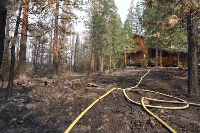 House in the Eiler Fire. Photo by Bill Gabbert.