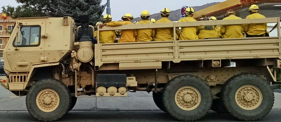 National Guard open truck hauling firefighters