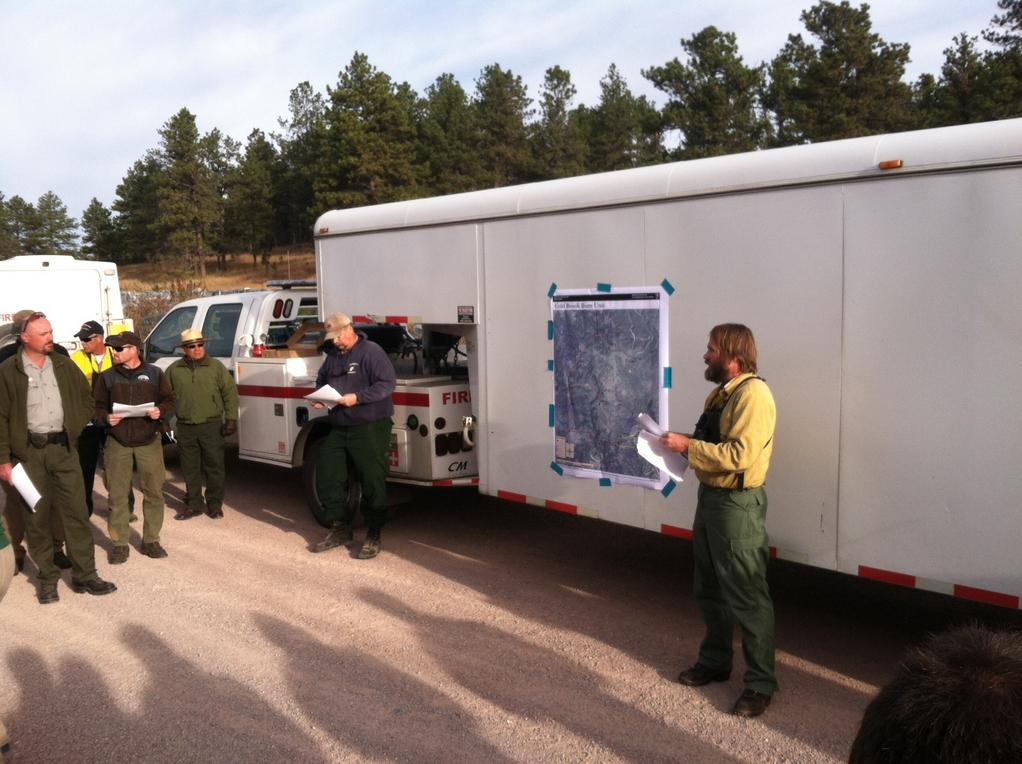 Eric Allen, the Fire Management Officer for the NPS' Northern Great Plains Area, conducts the briefing (as the Burn Boss) before the Cold Brook prescribed fire in Wind Cave National Park. NPS photo.