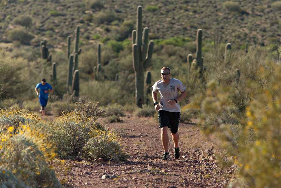 Ryan Conray leads James Robbins along a ridge line trail during the run portion of the Mesa Hotshots Desert Assesment.