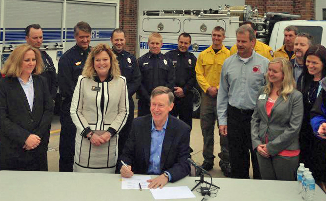 Janice Coen Gov. John Hickenlooper sign bill