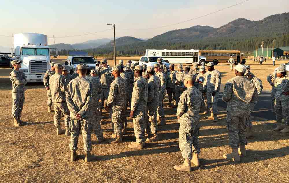 Members of the Army's Task Force First Round are briefed on the layout of the Incident Command Post after arriving at the Tower Fire, near Newport, Washington August 22, 2015. With more than 17 major fires burning in Washington alone, the 200 soldiers along with support personnel underwent fire suppression training prior to traveling from their home at Joint Base Lewis-McChord to assist in containing the blaze.