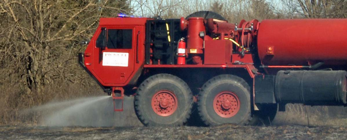 Four-axle former military HEMTT vehicle used as fire truck
