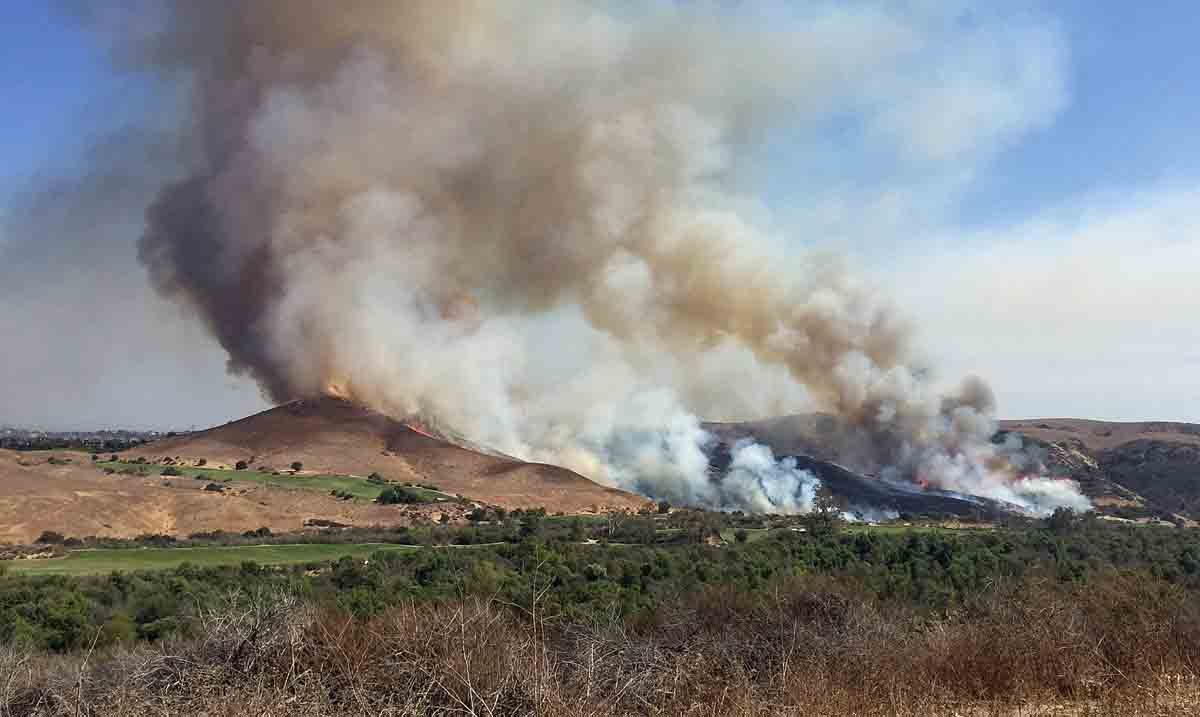 Trabuco Fire caused by golfer's club striking rock
