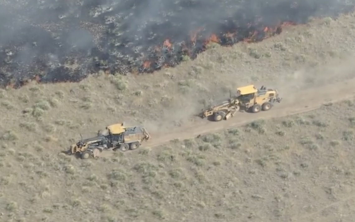 A tractor and graders help stop the Bradberry Fire in Colorado