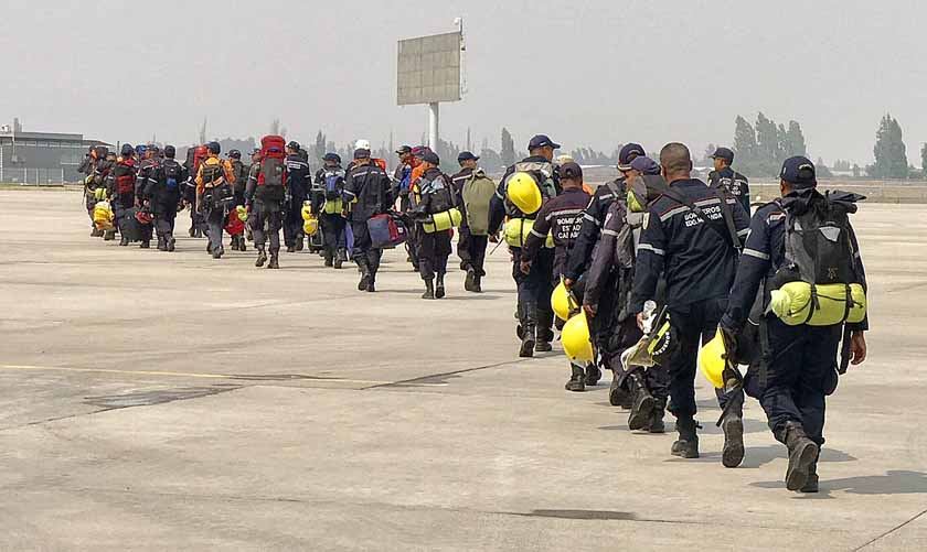 Firefighters Venezuela arrive Santiago, Chile