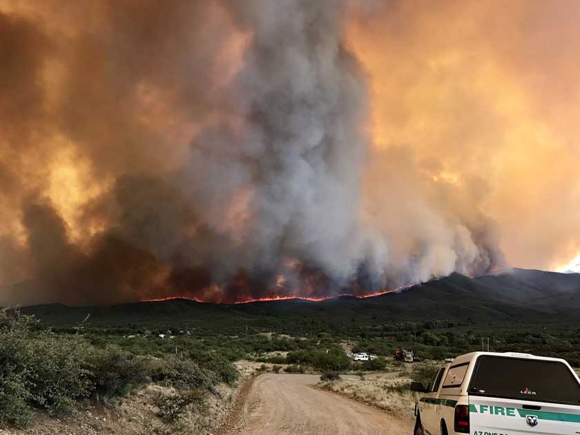 Arizona fire grows to 18000 acres, forces evacuations