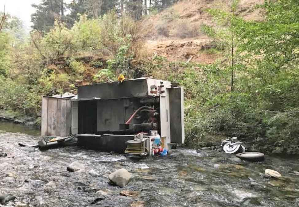 Another fire truck rollover — this time, into a creek