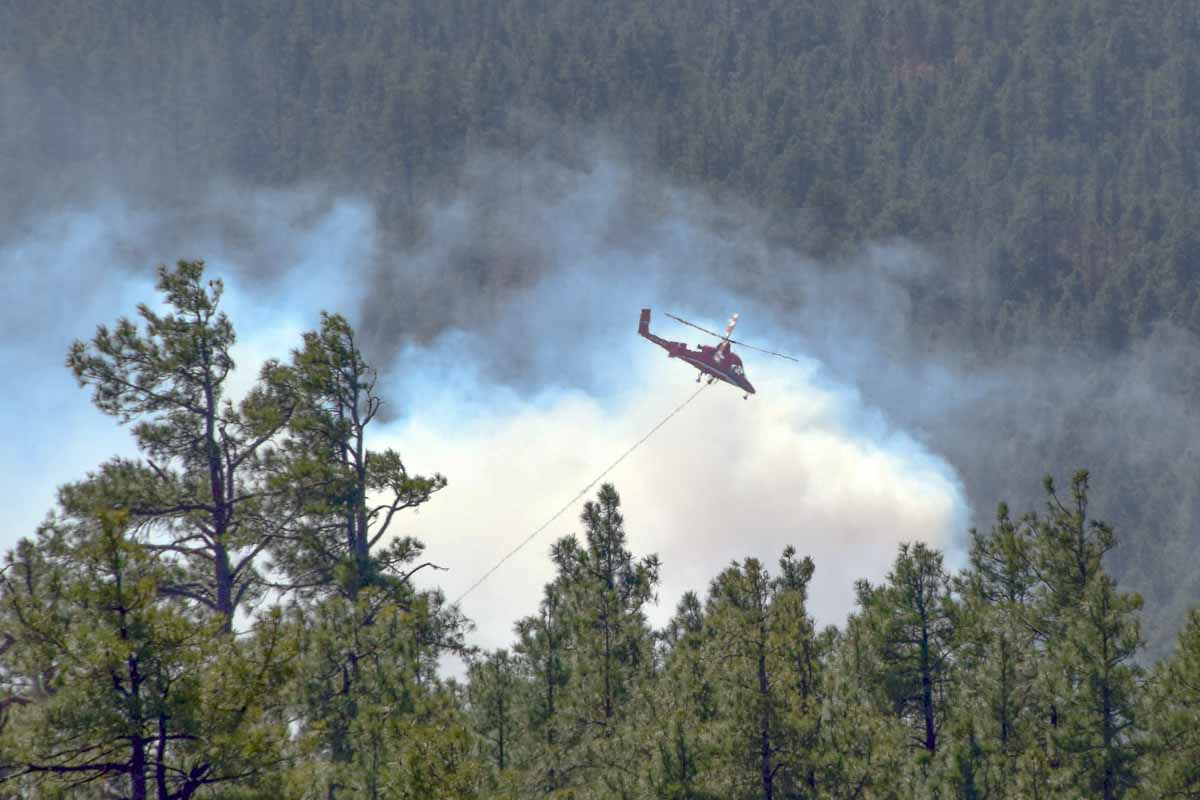 Aided by weather, firefighters keeping fire from spreading