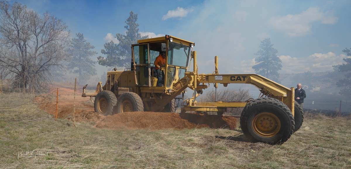 grader fence fire wildfire Hot Springs