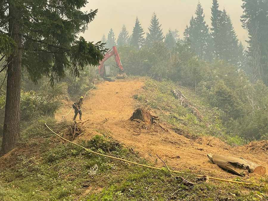 Firefighter and masticator on the McCash Fire.